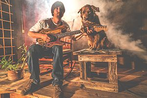 Frontman Scott Woodruff and Cocoa the Tour dog in 2016
