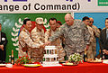 Senior military officers from the Republic of Korea and the United States of America cut the cake after the change of command ceremony for Multi-National Division - North East (MND-NE) at Camp Zaytun, Iraq 070429-M-KF728-037.jpg