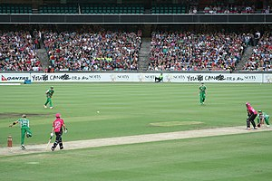 Shane Warne - Shane Warne bowling against Sydney Sixers in 2011 during a Big Bash League match