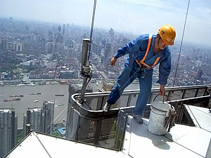 A window washer on one of skyscrapers in Shanghai