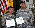 Sister, brother reenlist at Camp Striker DVIDS134953.jpg