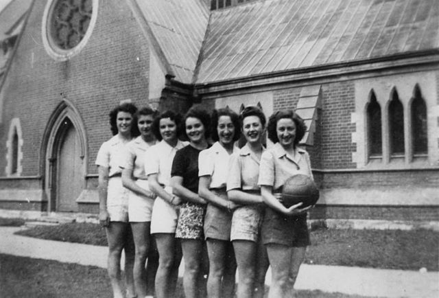 Women's netball team outside Holy Trinity Church, Fortitude Valley, ca. 1947