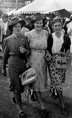 Townsville Showground - Three young women dressed up for a day at the Townsville Show, 1941