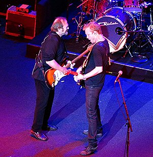Kenny Wayne Shepherd - Stephen Stills and Shepherd (front) and Barry Goldberg, not visible, performing as The Rides in Boston, Sept. 7, 2013.