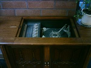 Entertainment center - Stereo console (Stereo radio, record changer and speakers integrated into one cabinet typical of the late 1960s)