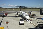 Sunstate Airlines 'QantasLink livery' (VH-QOI) Bombardier Dash-8 Q402 at Canberra Airport.jpg