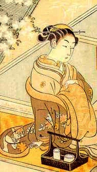 Oiran - An oiran sitting with a client, ukiyo-e print by Suzuki Harunobu (1765).