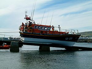 Slipway - Swanage lifeboat being winched back up its slipway after a launch.