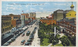 History of Tampa, Florida - A view north along Franklin Street c. 1910s-1920s. The old Hillsborough County Courthouse (demolished in 1966) is pictured on the right