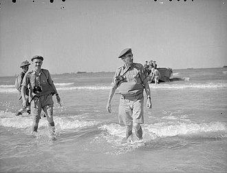 Guy Simonds - Major-General G. G. Simonds, commanding the 1st Canadian Infantry Division, coming ashore on Sicily, July 1943
