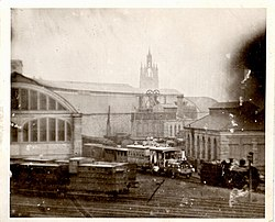 The Egyptian Viceroy's private 2-2-2 steam locomotive (Robert Stephenson Locomotive Works No 1181 of 1858) and its carriage outside the Newcastle Central Station in winter 1858.jpg