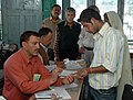 The Polling official administering indelible ink at the finger of a voter who came first time to exercising his franchise at a polling booth in DAV Sr. Sec. School, Lakkar Bazar, Shimla.jpg