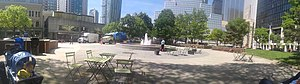 Berczy Park - prior to the 2015 renovation the park's central courtyard was surrounded by benches that faced its fountain.