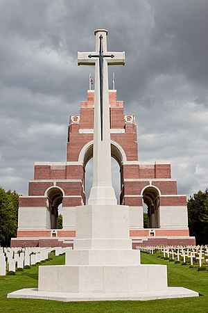 Thiepval Memorial - Cross of Sacrifice and British (left) and French (right) graves by the memorial