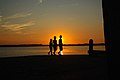 Three boys at the harbour of Schiermonikoog just before sunset..jpg