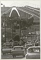 Traffic and line of telegraph poles approach the Gladesville Bridge, Oct 1966 (6998436013).jpg