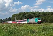 Long passenger train in a rural area