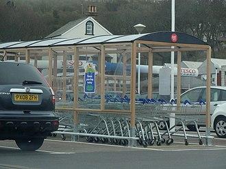 Shopping cart - Shopping cart bay in a UK supermarket parking lot