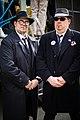Two men at carnival dressed as mafia bouncers (46717895894).jpg