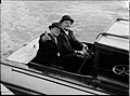 Two men seated in a motor launch, MISS PHYLISS, on Sydney Harbour (7397856426).jpg