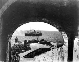 SS American Legion (1919) - USAT American Legion departing San Juan Bay (part of El Morro Castle in foreground). 1940