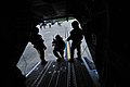U.S. Army MH-47G Chinook helicopter crew chiefs direct special operations personnel onto the aircraft during Emerald Warrior 2013 at Hurlburt Field, Fla., April 29, 2013 130429-F-MN146-025.jpg