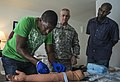 U.S. Army Maj. Timothy Aamland, center, a member of the Florida Army National Guard, supervises as a Royal Saint Lucia Police Force detective inserts an IV into a training dummy during emergency tactical medical 130523-N-KL795-555.jpg