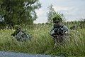 U.S. Army Sgt. Michael Montgomery, right, a Cavalry scout with Bravo Troop, 1st Squadron, 172nd Cavalry Regiment, 86th Infantry Brigade Combat Team, Vermont Army National Guard, surveys his surroundings during 130813-Z-KE462-078.jpg