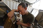 U.S. Marine Corps Cpl. Daisy A. Marrero Cardoza, a vehicle recovery operator with Marine Wing Support Squadron 271, replaces windshield wipers on a mine-resistant, ambush-protected all-terrain vehicle at Camp 130401-M-BU728-114.jpg