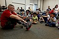 U.S. Marine Corps Gunnery Sgt. Ben Holmes discusses what it means to be odd with a group of children during the Military Child Education Coalition's, Tell Me a Story event in the Warrior Hope and Care Center 130430-M-LD192-101.jpg