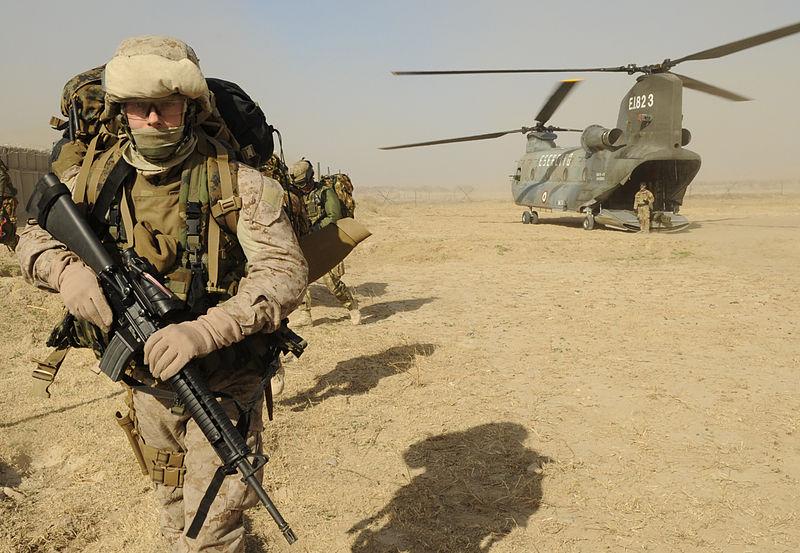 U.S. Marine Corps Sergeant exits an Italian Army CH-47 Chinook.jpg