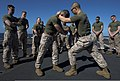 U.S. Marine Corps Sgt. David Yi, front right, a Marine Corps Martial Arts Program instructor with the 26th Marine Expeditionary Unit, demonstrates techniques to Marines on the flight deck of the amphibious 130322-N-WX580-052.jpg