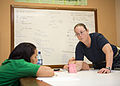 U.S. Navy Lt. Cmdr. Suzanne Maldarelli, right, a medical officer, conducts a subject matter expert exchange on advanced cardiac life support with Lissette Recinos, a public health nurse, at a hospital in Toledo 140627-N-XQ474-030.jpg