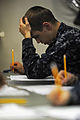 USS San Diego Sailors take advancement exam 150319-N-RC734-009.jpg