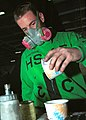 US Navy 020410-N-1280S-001 USS Washington - mixing paint.jpg