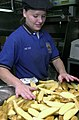 US Navy 030412-N-1577S-004 Mess Management Specialist Seaman Kelly Meyer from Lancherry, Mich., prepares potatoes for the crew aboard USS Nimitz (CVN 68).jpg