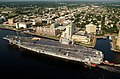 US Navy 030820-N-9851B-013 Tug boats guide USS Harry S. Truman (CVN 75) up the Elizabeth River, past Portsmouth landmarks, to the Norfolk Naval Shipyard.jpg