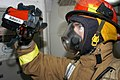 US Navy 050713-N-3143M-040 A Sailor assigned to Repair Locker Four, uses a Navy Firefighting Thermal Imager (NFTI) to locate hot spots for his fire team.jpg