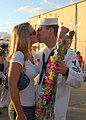 US Navy 061212-N-9486C-001 Electronics Technician 1st Class Ryan Sweetser greets his wife after fast-attack submarine USS Buffalo (SSN 715) returned from a six-month deployment to the western Pacific.jpg