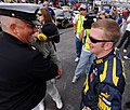 US Navy 070504-N-5345W-053 NASCAR Busch Series driver Shane Huffman, driver of the ^88 U.S. Navy Chevy Monte Carlo, shares a laugh with a Navy senior chief after qualifying a career-high 3rd for the Circuit City 250 at Richmond.jpg