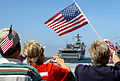 US Navy 070531-N-4163T-180 Family and friends cheer as the dock landing ship USS Comstock (LSD 45) pulls into port at Naval Base San Diego.jpg