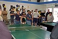 US Navy 071009-N-3570S-016 Master Chief Culinary Specialist Terry Delacruz, of Navy of Operational Support Center San Jose, hits the ball during a ping-pong match with teens at Tracy Wilson YMCA San Jose.jpg
