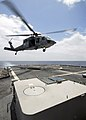 US Navy 080718-N-4236E-223 An MH-60S assigned to Helicopter Sea Combat Squadron (HSC) 28 brings mail, supplies, and food aboard the guided-missile cruiser USS Vella Gulf (CG 72).jpg