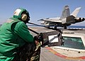 US Navy 080823-N-7282P-038 An aviation boatswain mate flashes the wait time as an F-A-18C Hornet from the.jpg