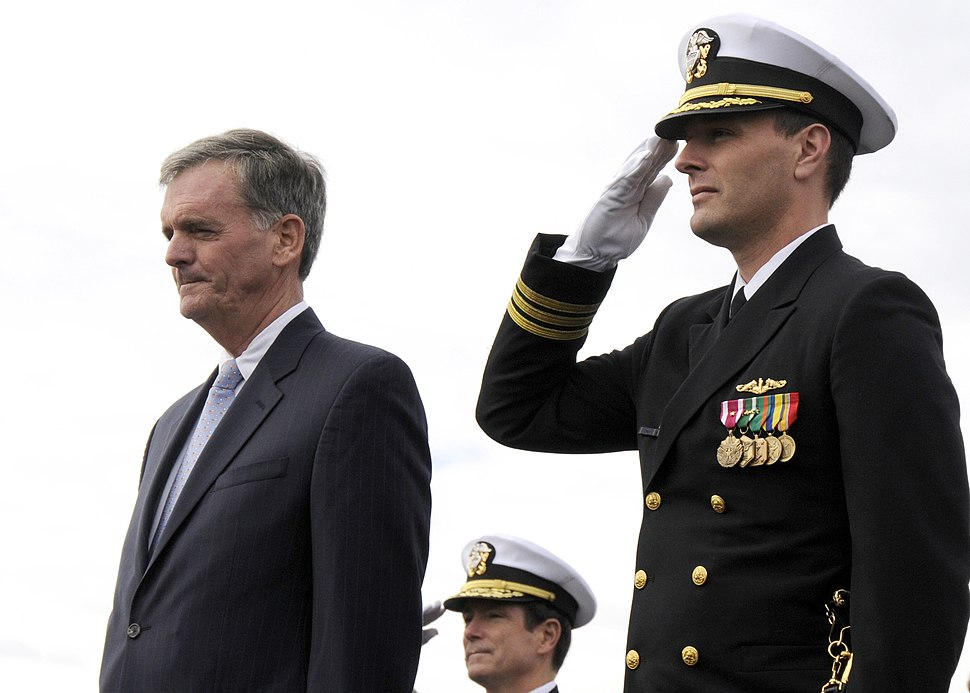 US Navy 081025-N-6553L-005 Cmdr. Mike Stevens, commanding officer of the Virginia-class attack submarine USS New Hampshire (SSN 778), right, and Vice Adm. John Donnally, Commander Submarine Force, center, salute as honors are r