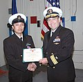 US Navy 090106-N-4909P-001 ear Adm. Andy Brown presents Chief Storekeeper Chester Gorriceta with the purple heart medal for injuries suffered March 13, 2008, while deployed to Afghanistan.jpg