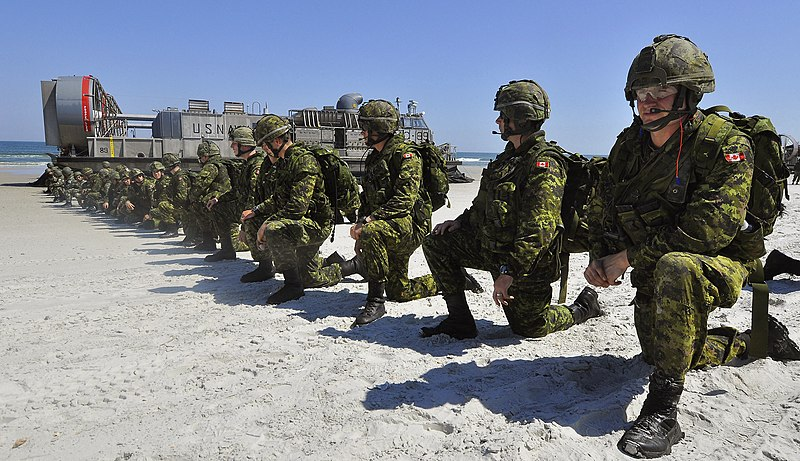 File:US Navy 090424-G-6464J-013 Canadian soldiers set a perimeter position after disembarking a U.S. Navy landing craft during a simulated amphibious landing.jpg
