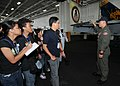 US Navy 090813-N-6233H-028 Lt. j.g. Kyler Chong, assigned to the Diamondbacks of Strike Fighter Squadron (VFA) 102, explains how an F-A 18C Hornet operates to students from Manila high schools.jpg