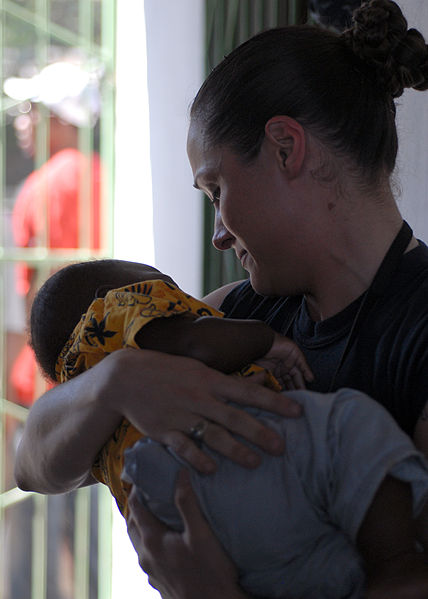 File:US Navy 100202-N-4971L-162 Sailor helps Haitian woman by holding baby.jpg