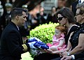 US Navy 100408-N-5416W-303 Cmdr. Dave Mundy, executive officer of the Bluetails of Carrier Airborne Early Warning Squadron (VAW) 121, presents an American flag to the widow of Lt. Miroslav Steven Zilberman during his memorial.jpg